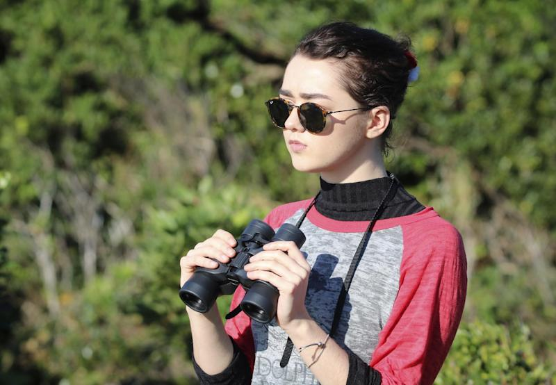 """In this photo released by DolphinProject, Maisie Williams monitors dolphin hunting boats in Taiji, Wakayama prefecture, central Japan, Friday, Dec. 2, 2016. """"Game of Thrones"""" star Williams, 19, wants everyone to stop buying tickets to marine shows, the best way, she thinks, to stop the dolphin capture and killing in Japan. Williams spoke Friday from the small Japanese town of Taiji, made famous in """"The Cove"""" an Oscar-winning film that documented the dolphin hunt and starred Ric O'Barry, the dolphin trainer for the """"Flipper"""" TV series. (Lincoln O'Barry via AP)"""