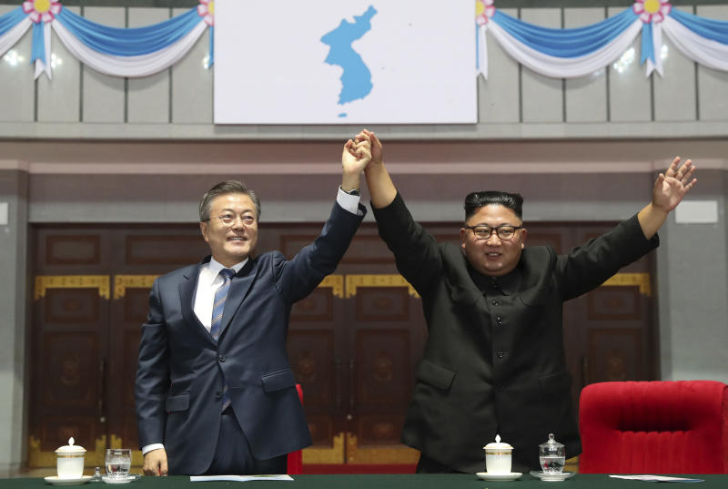 "In this Wednesday, Sept. 19, 2018, file photo, South Korean President Moon Jae-in and North Korean leader Kim Jong Un raise their hands after watching the mass games performance of ""The Glorious Country"" at May Day Stadium in Pyongyang, North Korea. (Pyongyang Press Corps Pool via AP, File)"