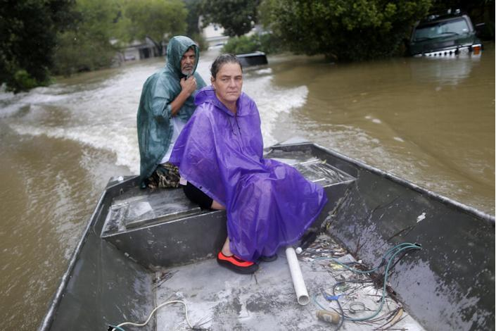 Curtis and Michelle Bertrand look for residents to rescue in Beaumont Place, Houston, on Monday. (Photo: Jonathan Bachman/Reuters)