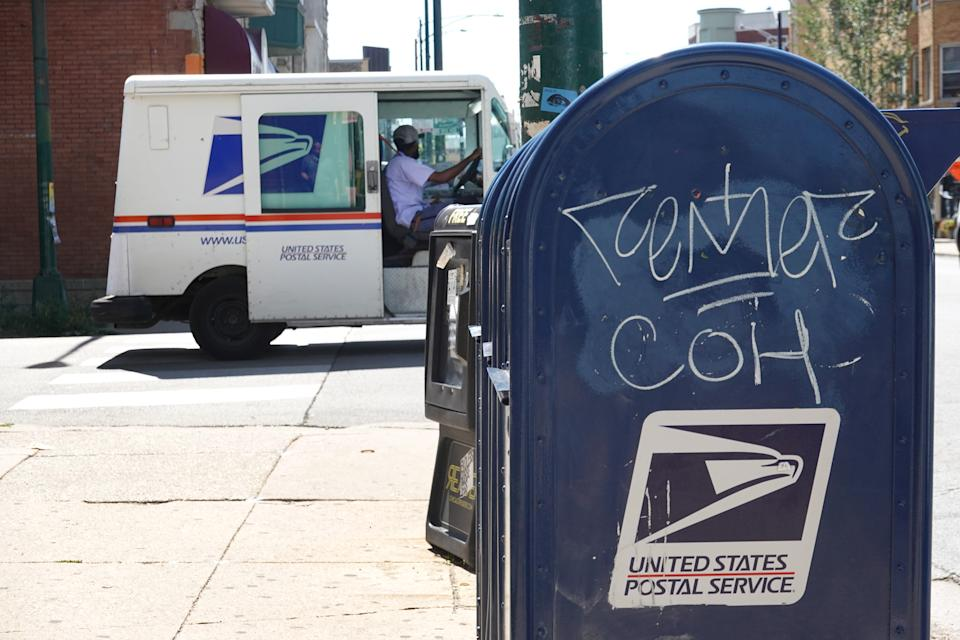CHICAGO, ILLINOIS - AUGUST 13: Mail boxes sit in front of a United State Postal Service facility on August 13, 2020 in Chicago, Illinois.  President Donald Trump said today that he opposes additional funding for the Postal Service because the lack of additional funding would make it more difficult to deliver mail-in ballots. (Photo by Scott Olson/Getty Images)