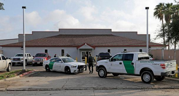 PHOTO: A U.S. Border Patrol Agent walks between vehicles outside the Central Processing Center in McAllen, Texas. (AP Photo/David J. Phillip)