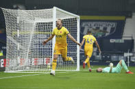 Tottenham's Harry Kane, left, celebrates after scoring his side's opening goal during the English Premier League soccer match between West Bromwich Albion and Tottenham Hotspur at the Hawthorns in West Bromwich, England, Sunday, Nov. 8, 2020. (AP Photo/Dave Thompson, Pool)