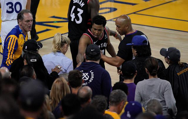 Toronto Raptors guard Kyle Lowry was pushed by Warriors part-owner Mark Stevens, who was seated courtside for Game 3 of the NBA Finals. (AP Photo/Tony Avelar)