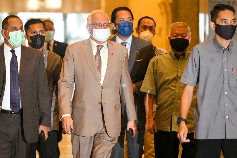 Malaysia's former prime minister Najib Razak (C) is appealing against his conviction on 1MDB-linked corruption charges