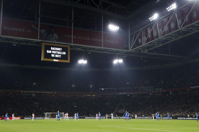 The Ajax and Heracles players had plenty of support during their protest against racism. (Photo by ANP Sport via Getty Images)