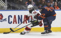 New Jersey Devils' P.K. Subban (76) is chased by Edmonton Oilers' Oscar Klefbom (77) during the first period of an NHL hockey game Friday, Nov. 8, 2019, in Edmonton, Alberta. (Jason Franson/The Canadian Press via AP)