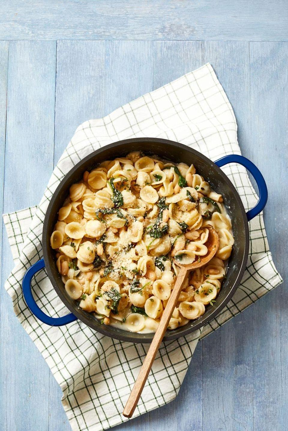 """<p>Hearty orecchiette pasta gets a flavor boost from plenty of golden garlic and Parm. Not eating gluten? Make it with one of our favorite <a href=""""https://www.goodhousekeeping.com/food-products/g32353970/best-gluten-free-pastas/"""" rel=""""nofollow noopener"""" target=""""_blank"""" data-ylk=""""slk:gluten-free pastas"""" class=""""link rapid-noclick-resp"""">gluten-free pastas</a>.<br></p><p><em><a href=""""https://www.goodhousekeeping.com/food-recipes/a34463100/orecchiette-with-white-beans-and-spinach-recipe/"""" rel=""""nofollow noopener"""" target=""""_blank"""" data-ylk=""""slk:Get the recipe for Orecchiette With White Beans and Spinach »"""" class=""""link rapid-noclick-resp"""">Get the recipe for Orecchiette With White Beans and Spinach »</a></em></p>"""