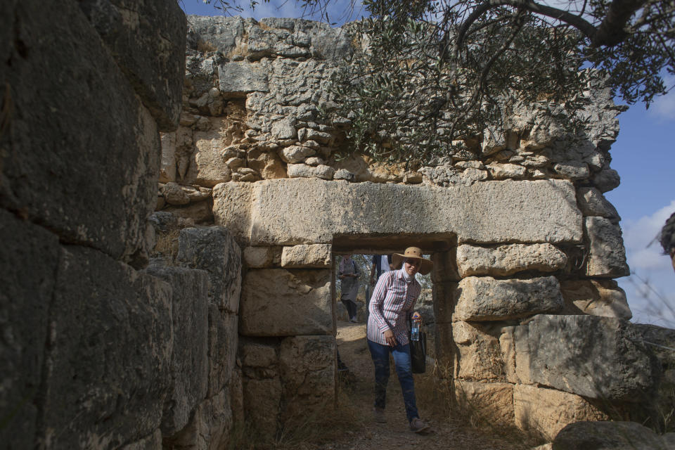 """Hikers explore Deir Qalaa, """"Monastery of the Castle,"""" the remains of a Byzantine monastery near the Jewish settlement of Peduel and the Palestinian village of Deir Balout, west of the West Bank city of Salfit, Friday, June. 11, 2021. A growing number of Palestinians are taking up hiking, which offers a way to explore the countryside and historical landmarks in the Israeli-occupied West Bank. (AP Photo/Nasser Nasser)"""