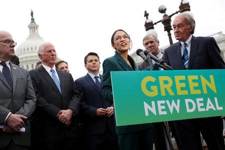 """FILE PHOTO: U.S. Representative Ocasio-Cortez and Senator Markey hold a news conference for their proposed """"Green New Deal"""" at the U.S. Capitol in Washington"""