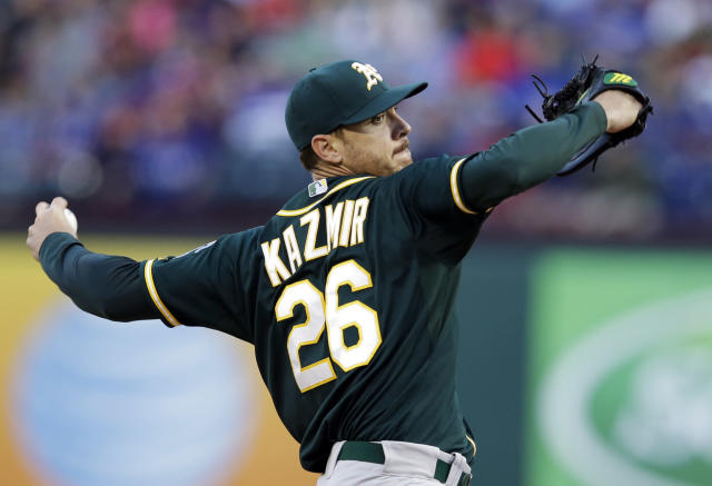 Oakland Athletics starting pitcher Scott Kazmir delivers to the Texas Rangers in the first inning of a baseball game, Tuesday, April 29, 2014, in Arlington, Texas. (AP Photo/Tony Gutierrez)