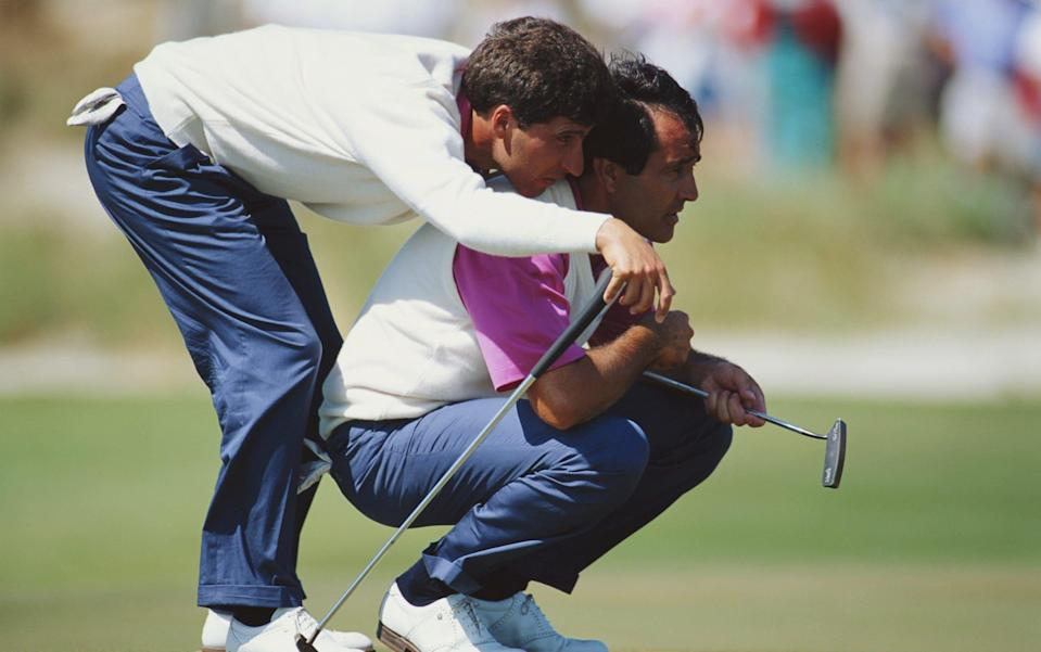 Jose-Maria Olazabal of Spain uses the shoulders of Seve Ballesteros - Getty Images