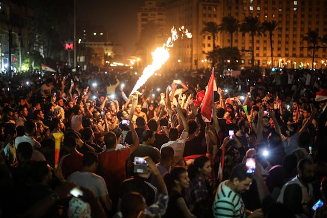Egypt fans celebrate in Cairo after their national team qualified for the World Cup. (Getty)