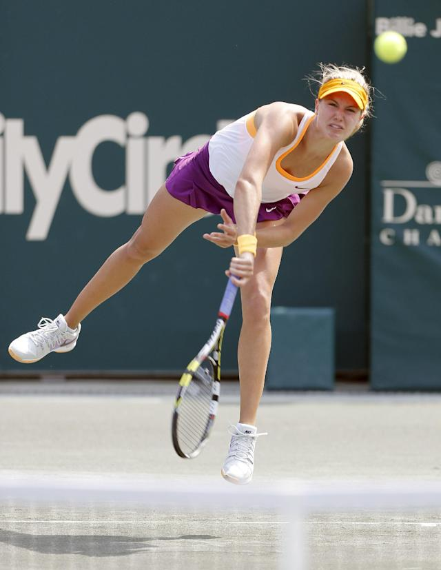 Eugenie Bouchard, of Canada, serves to Venus Williams during the Family Circle Cup tennis tournament in Charleston, S.C., Thursday, April 3, 2014. (AP Photo/Mic Smith)