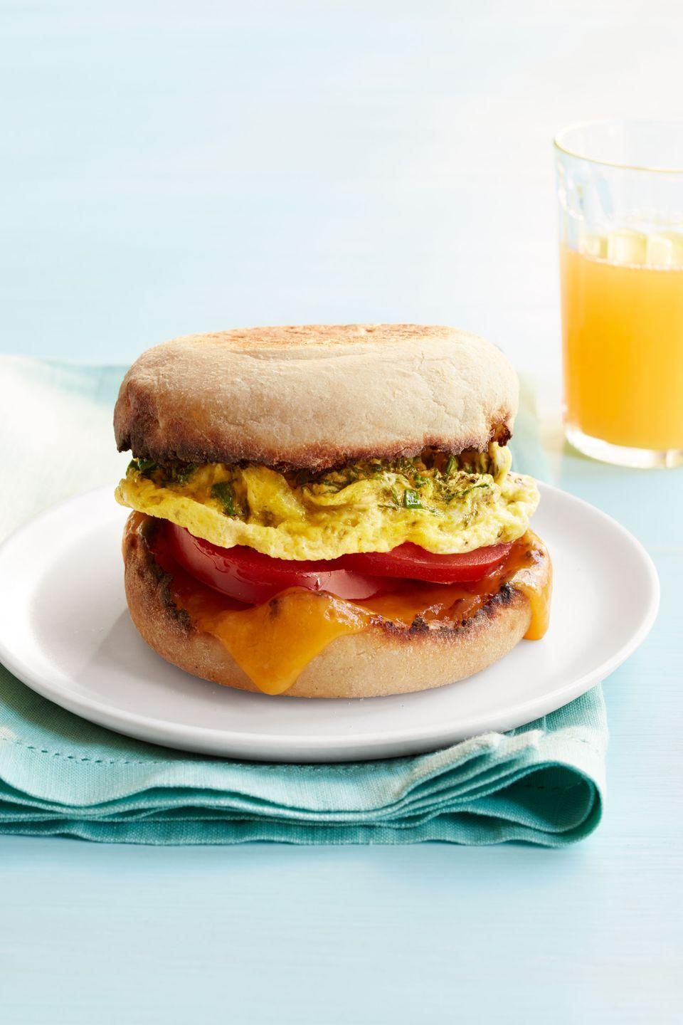 "<p>This protein-packed breakfast is ready in five minutes thanks to a little help from your <a href=""https://www.womansday.com/food-recipes/cooking-tips/a51830/youll-be-shocked-to-hear-why-you-shouldnt-reheat-these-common-foods/"" rel=""nofollow noopener"" target=""_blank"" data-ylk=""slk:trusty microwave"" class=""link rapid-noclick-resp"">trusty microwave</a>.</p><p><a href=""https://www.womansday.com/food-recipes/food-drinks/recipes/a53590/egg-sandwich/"" rel=""nofollow noopener"" target=""_blank"" data-ylk=""slk:Get the No-Skillet Egg Sandwich recipe."" class=""link rapid-noclick-resp""><em>Get the No-Skillet Egg Sandwich recipe.</em></a></p>"