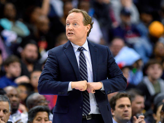 FILE - In this April 6, 2018, file photo, Atlanta Hawks coach Mike Budenholzer gestures during the second half of the team's NBA basketball game against the Washington Wizards in Washington. The Hawks and Budenholzer mutually agreed to part ways on Wednesday, April 25, according to the team. The Hawks announced the move Wednesday night in a brief three-sentence statement. (AP Photo/Nick Wass, File)