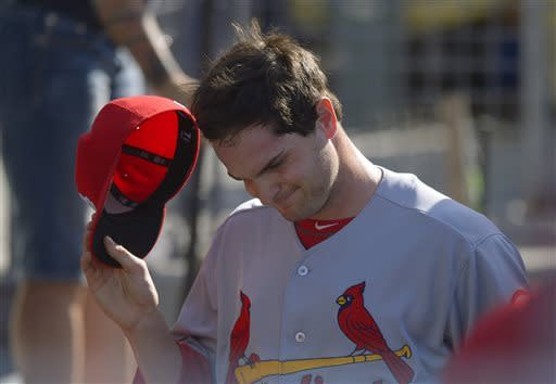 St. Louis Cardinals starting pitcher John Gast takes off his cap after being taken out of a baseball game during the second inning against the Los Angeles Dodgers, Saturday, May 25, 2013, in Los Angeles. (AP Photo/Mark J. Terrill)