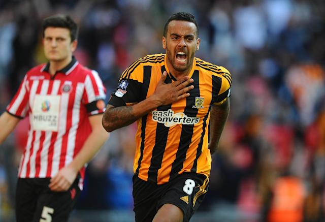 LONDON, ENGLAND - APRIL 13: Tom Huddlestone of Hull City celebrates scoring their third goal during the FA Cup with Budweiser semi-final match between Hull City and Sheffield United at Wembley Stadium on April 13, 2014 in London, England. (Photo by Mike Hewitt/Getty Images)