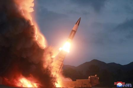 FILE PHOTO: KCNA picture of North Korea test firing a new weapon