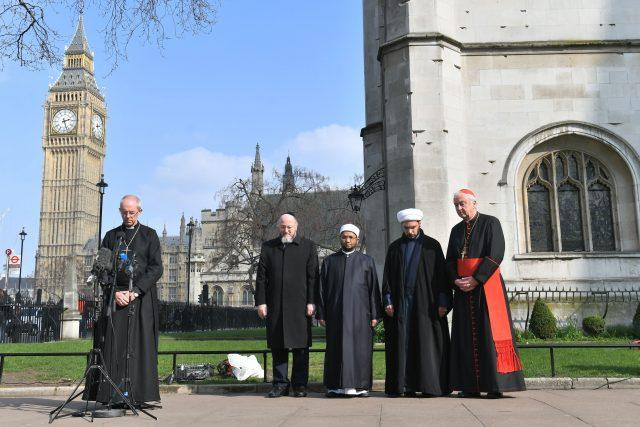 From left, Archbishop of Canterbury Justin Welby, Chief Rabbi Ephriam Mirvis, Sheikh Ezzat Khalifa, Sheikh Mohammad al Hilli and Cardinal Vincent Nichols, Archbishop of Westminster, take part in a vigil outside Westminster Abbey, London, for the victims of the Westminster terror attack (Victoria Jones/PA)