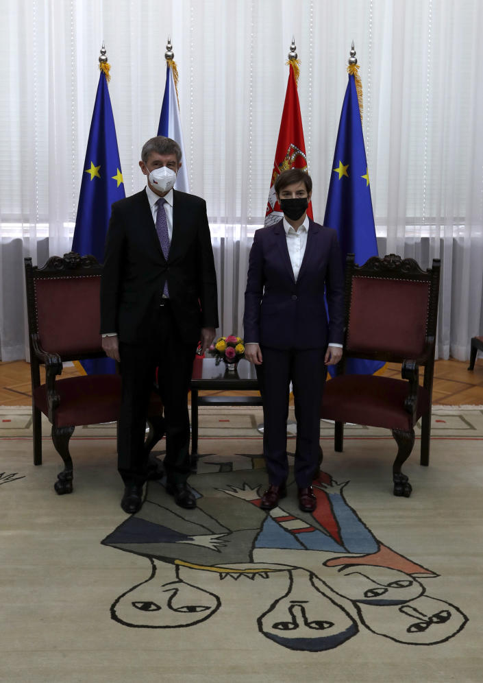 Czech Prime Minister Andrej Babis, left, poses with his Serbian counterpart Ana Brnabic ahead of meeting at the Serbia Palace in Belgrade, Serbia, Wednesday, Feb. 10, 2021. Babis is on a one-day official visit to Serbia. (AP Photo/Darko Vojinovic)