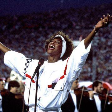 """<div class=""""caption-credit""""> Photo by: ImageCollect</div><div class=""""caption-title"""">Whitney Sings The Star-Spangled Banner</div>The Gulf War took center stage during the opening minutes at Super Bowl XXV in 1991. Whitney Houston, then at the top of her game, sang an emotional Star-Spangled Banner that had many in the crowd in tears. Concern about the war was running so high the halftime show (New Kids On The Block) was delayed until after the game so that during intermission, ABC could bring fans up to date on Operation Desert Storm."""