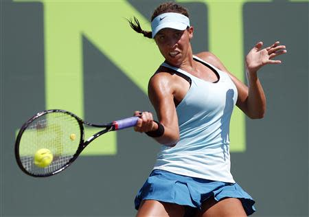 Mar 23, 2014; Miami, FL, USA; Madison Keys hits a forehand against Li Na (not pictured) on day seven of the Sony Open at Crandon Tennis Center. Mandatory Credit: Geoff Burke-USA TODAY Sports