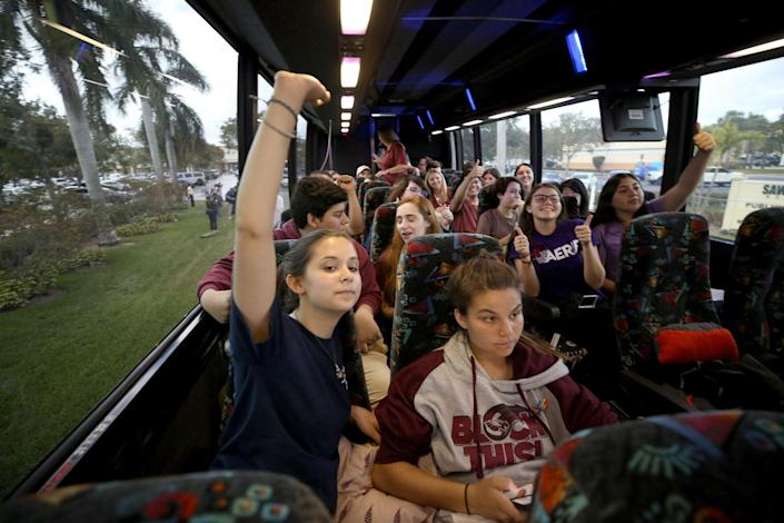 <p>Julia Salomone, 18, and her sister Lindsey, 15, both students at Marjory Stoneman Douglas, join their classmates in a cheer as they leave Coral Springs on a bus headed to Tallahassee, Fla. on Tuesday, Feb. 20, 2018. (Photo: Susan Stocker/Sun Sentinel/TNS via Getty Images) </p>