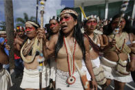 Waoranis and leader Nemonte Nenquimo leave a courthouse after a judged ruled in their favor in a lawsuit filed against the Ministry of Non-Renewable Natural Resources for opening up oil concessions on their ancestral land, in Puyo, Ecuador, Friday, April 26, 2019. The Amazon tribe has won an early court victory in its fight to stop oil extraction in its ancestral territory. A judge in a provincial court determined Friday that the Waorani people have a right to be consulted before any oil drilling takes place. (AP Photo/Dolores Ochoa)