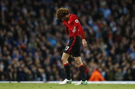 Britain Soccer Football - Manchester City v Manchester United - Premier League - Etihad Stadium - 27/4/17 Manchester United's Marouane Fellaini looks dejected after being sent off Action Images via Reuters / Jason Cairnduff Livepic