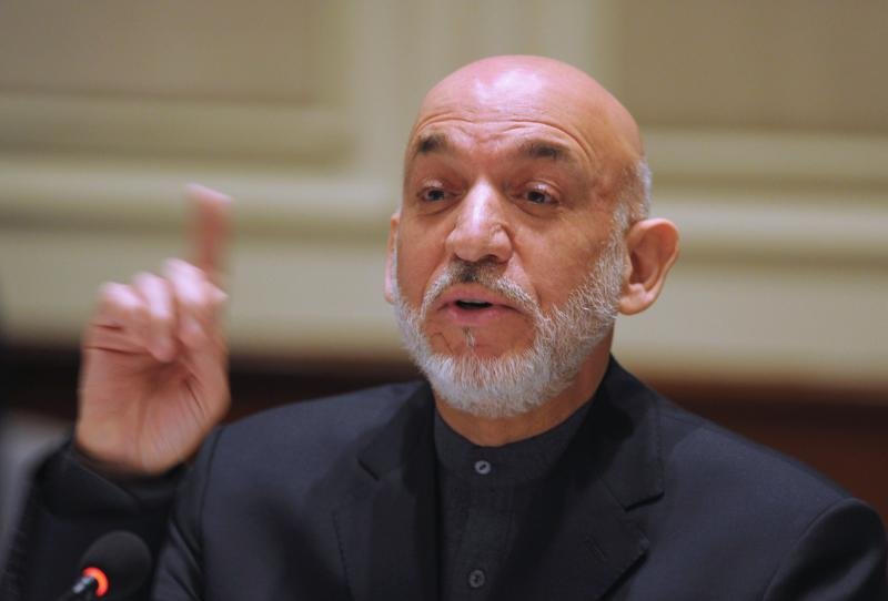 Afghanistan's President Hamid Karzai gestures as he addresses media representatives during a press interaction in New Delhi December 14, 2013. Karzai is on a four-day visit to India. REUTERS/Findlay Kember/Pool (INDIA - Tags: POLITICS)