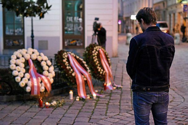 PHOTO: A pedestrian prays at the wreaths laid by the Austrian government at a crime scene in the city center the day after a deadly shooting spree, Nov. 3, 2020, in Vienna, Austria. (Thomas Kronsteiner/Getty Images)