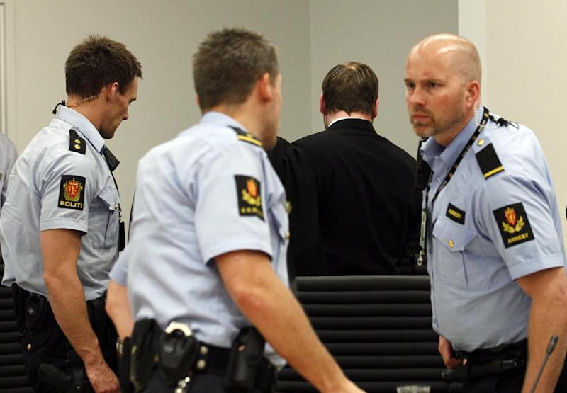 Terror charged Anders Behring Breivik is escorted out by the police as he leaves the court room at the end of the last day of the 10 weeks long trial in Oslo, Friday, June 22, 2012. On the last day of his trial, Anders Behring Breivik's defense lawyers on Friday tried to cast the confessed mass killer as a political militant motivated by an extreme right-wing ideology rather than a delusional madman who killed 77 people for the sake of killing. (AP Photo/Heiko Junge/pool)