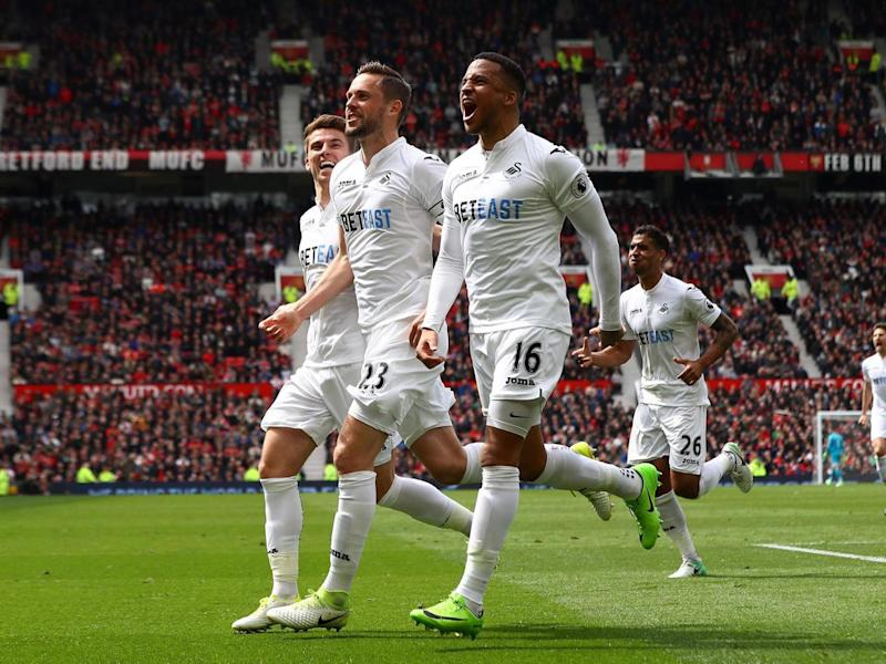 Swansea celebrate their equaliser (Getty)