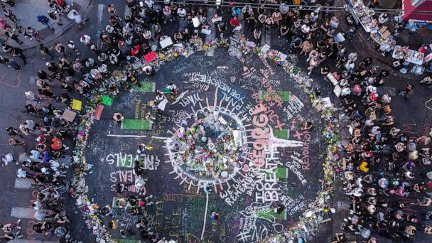 PHOTO: A view of protesters gathered near the makeshift memorial in honor of George Floyd marking one week anniversary of his death, on June 1, 2020 in Minneapolis, Minn. (Chandan Khanna/AFP via Getty Images)
