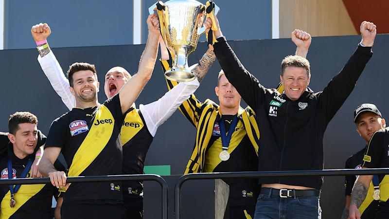 Pictured here, Richmond Tigers celebrate their 2019 AFL premiership win.