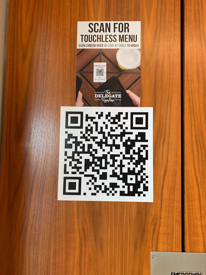 Get used to using your phone to check out menus the next time you stay at a hotel.