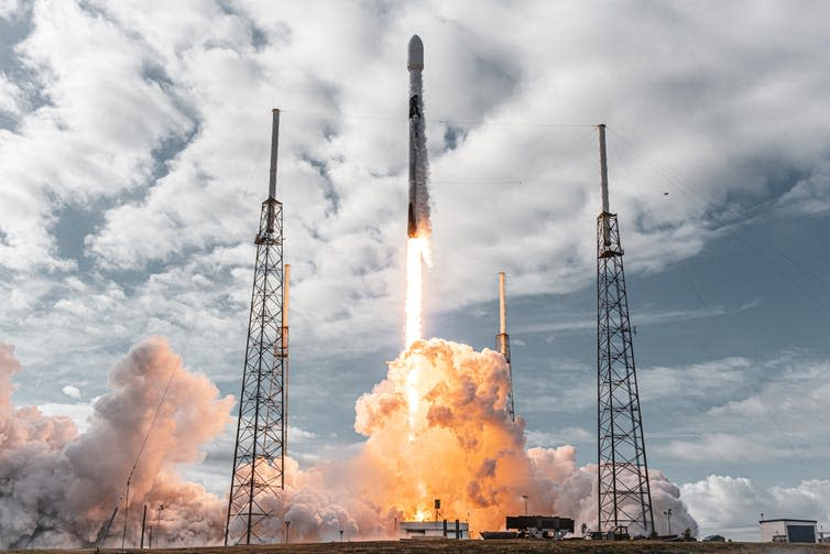 A SpaceX rocket being fired.