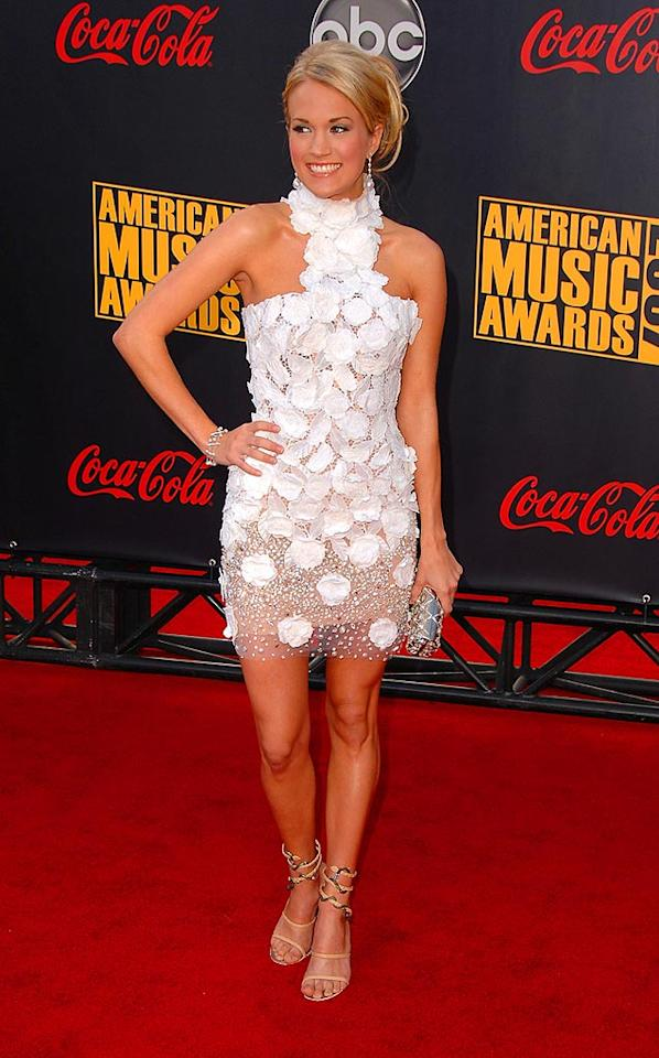 """Carrie Underwood's white and silver George Chakras creation contrasts beautifully with her bronze skin. Steve Granitz/<a href=""""http://www.wireimage.com"""" target=""""new"""">WireImage.com</a> - November 18, 2007"""
