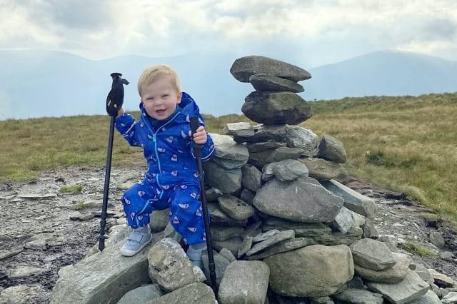 A baby was on top of the world as he tottered around a mountain summit