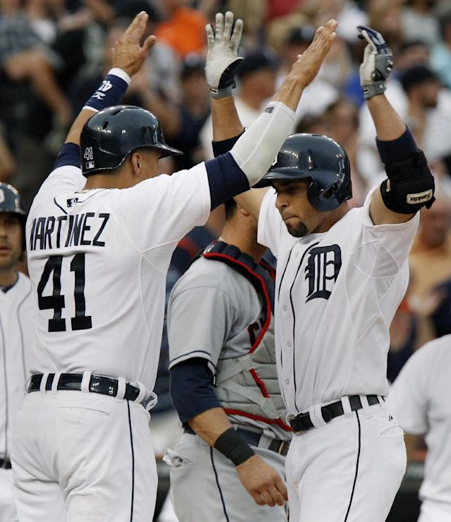 Detroit Tigers' Omar Infante, right, celebrates his three-run home run with Victor Martinez in the second inning of a baseball game against the Cleveland Indians Saturday, Aug. 31, 2013, in Detroit. (AP Photo/Duane Burleson)
