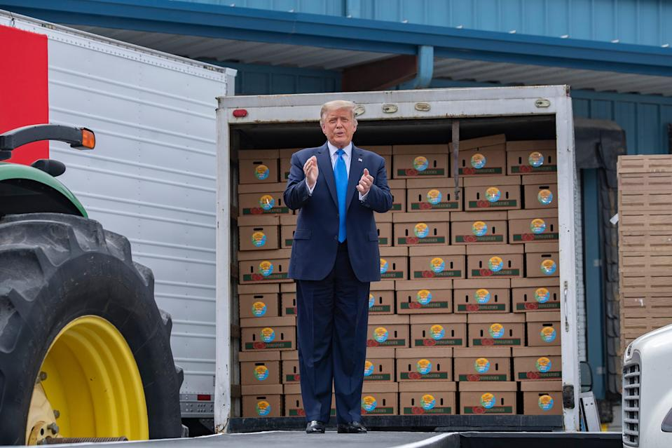 President Donald Trump is introduced to give remarks after touring Flavor 1st Growers and Packers, a farmer-owned produce packing plant in Mills River, on Aug. 24, 2020.