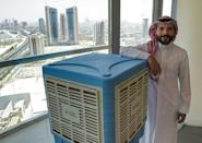 Mohammed Abdelaal's company Silent Power uses solar technology to cool water tanks (AFP/Mazen Mahdi)