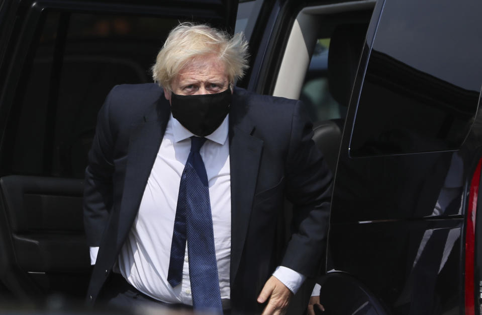 Britain's Prime Minister Boris Johnson arrives at the Northern Ireland Ambulance Service HQ during his visit to Belfast, Thursday, Aug. 13, 2020. (Brian Lawless/PA via AP)