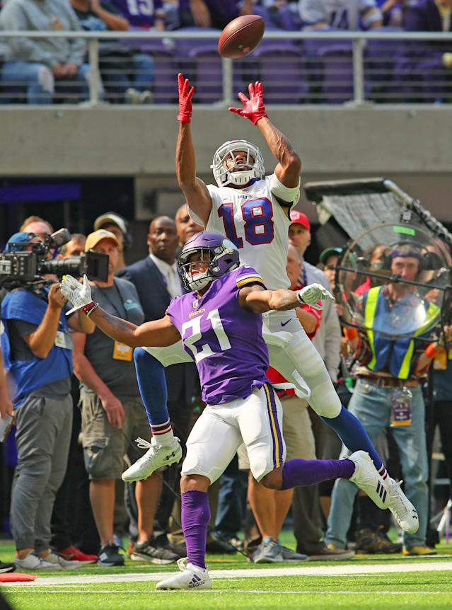 <p>Andre Holmes #18 of the Buffalo Bills attempts to catch the ball over defender Mike Hughes #21 of the Minnesota Vikings in the first half of the game at U.S. Bank Stadium on September 23, 2018 in Minneapolis, Minnesota. The play was ruled incomplete. (Photo by Adam Bettcher/Getty Images) </p>