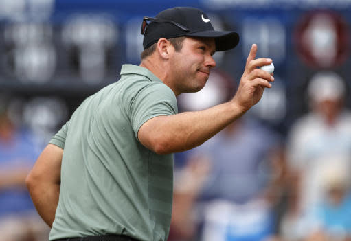 Paul Casey acknowledges the crowd after his putt on the 16th hole during the final round of the Valspar Championship golf tournament Sunday, March 11, 2018, in Palm Harbor, Fla. (AP Photo/Mike Carlson)