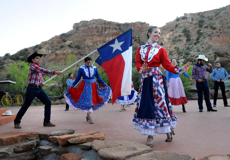 """In this May 21, 2013 photo, """"Texas"""" cast members rehearse on stage at the Pioneer Amphitheatre in Palo Duro Canyon, Texas. Five cast members of the musical were killed in an automobile accident Monday night, Aug. 12, 2013 near Dumas, Texas, said Christopher Ray, a Texas Department of Public Safety spokesman. (AP Photo/Amarillo Globe-News, Sean Steffen)"""