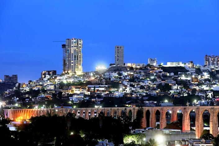 "Newly constructed high-rise residential buildings just outside Querétaro's historic downtown, with its 18th century aqueduct in the foreground. <span class=""copyright"">(Gary Coronado / Los Angeles Times)</span>"
