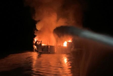 Ventura County Fire Department personnel respond to a boat fire off Santa Cruz Island