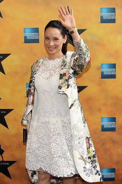 <p>Lucy Liu wore a head-to-toe look — a white lace dress and a white silk dress with a lovely floral bouquet — from Monique Lhuillier's Resort 2016 collection.</p>