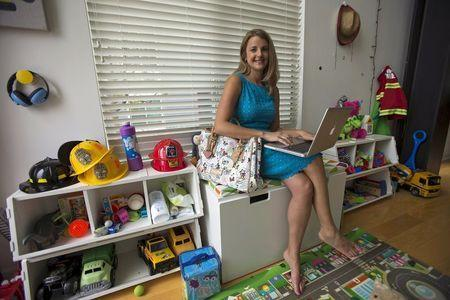 Chief executive of California-based social and educational group for parents Club MomMe Rachel Pitzel poses for a picture at her home in Playa Vista, California, June 10, 2015. REUTERS/Mario Anzuoni